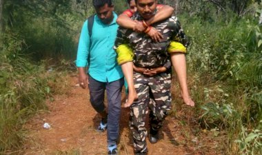 Muslim cop carries two devotees on back for medical aid at Tirumala.